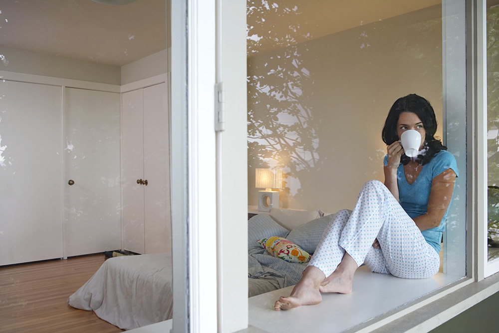 Lady self-isolating at home during COVID pandemic