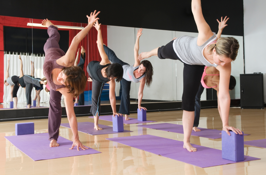 Group of people doing pilates exercises
