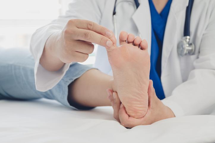 Doctor examining a patient's diabetic foot