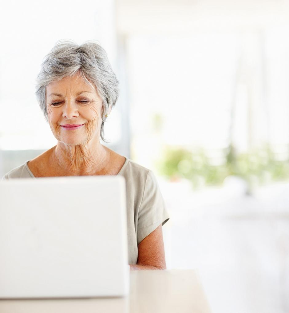 Lady having virtual physio consultation in front of computer
