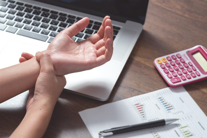 Office worker computer use repetitive strain injury to the wrist