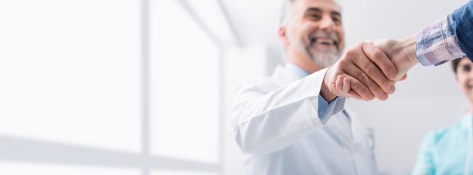 Doctor and patient congratulatory handshake