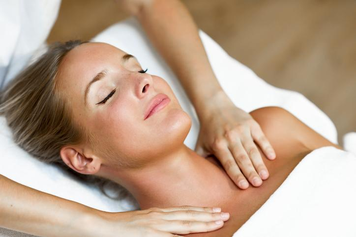Female having shoulder and neck massage therapy