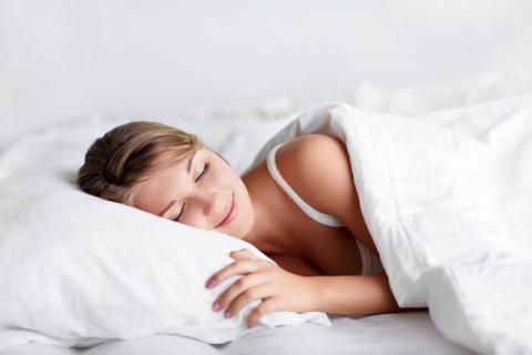 Girl sleeping happily on good pillow